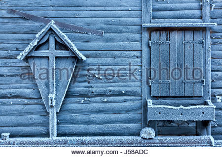 Detail on the exterior wall of a wooden chalet covered with frost, ansiei valley, auronzo di cadore, belluno, dolomites - Stock Photo