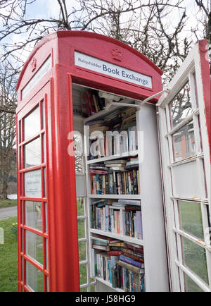 Balquhidder Book Exchange in an old red telephone kiosk, Balquhidder, Perthshire, Scotland - Stock Photo