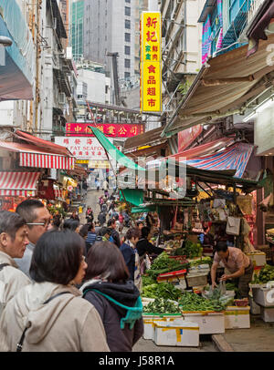 Hong Kong,China. Typical open fronted greengrocer's shop stall in Gage Street. - Stock Photo