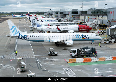 A Flybe Embraer plane on push back - Stock Photo