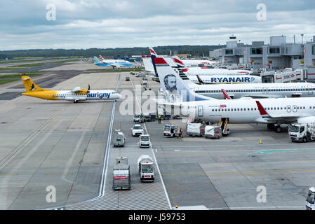 Aircraft movements on a overcast morning at the South terminal London Gatwick airport England UK. April 2017 - Stock Photo