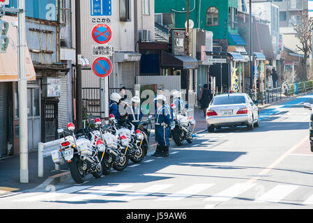 a line of police motorcycles in Tokyo, Japan - Stock Photo