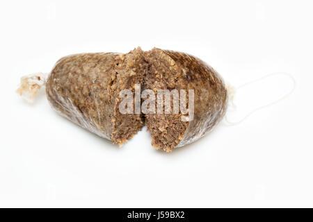 Cooked Scottish haggis isolated on a white studio background. - Stock Photo