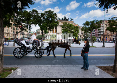 PALERMO, ITALY - October 14, 2009: The Politeama Garibaldi theater in Palermo, Sicily, horse cart - Stock Photo