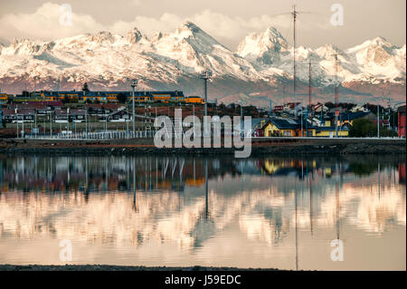 Reflection of the most southern city of Argentina in serene morning water of the Beagle Channel. Ushuaia is the - Stock Photo