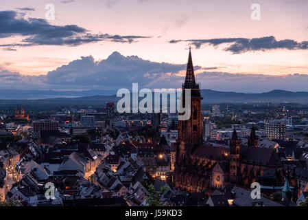 Sunset view of Freiburg, Germany with the Freiburg Munster (Cathedral) in the foreground. - Stock Photo