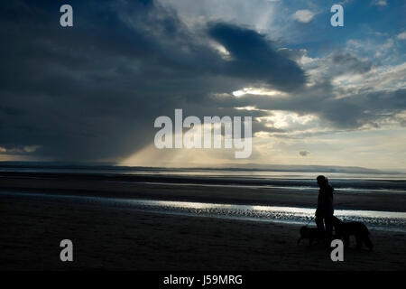 A storm over Hinkley  Point  nuclear power station in the Severn Estuary, approaching Burnham-on-Sea, Somerset, - Stock Photo