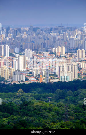 Urban skyline of Sao Paulo shot from the forest in the Serra da Cantareira mountains Stock Photo