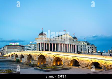 The Old Stone Bridge and Museum of Archaeology across River Vardar at dusk, Skopje, Skopje Region, Republic of Macedonia - Stock Photo