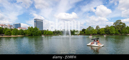 May 2017, Houston, Texas:  A panoramic view of the Hermann Park McGovern Lake with people on pedal boats and the - Stock Photo