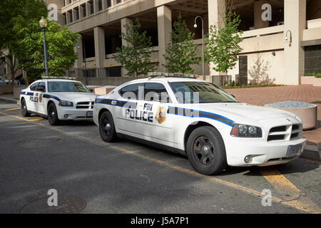 fbi police cars outside federal bureau of investigation fbi headquarters j edgar hoover building Washington DC USA - Stock Photo