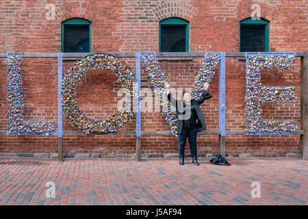 Tourist in front of the word love written with locks, padlocks, love symbol, love concept, valentine, heart padlock, - Stock Photo