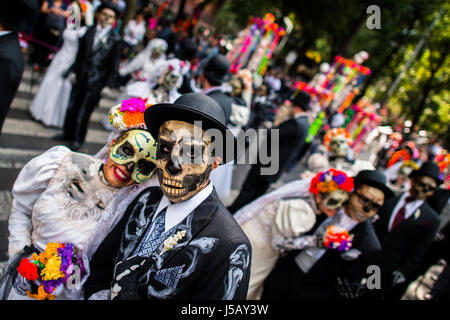 Young couples, costumed as La Catrina, walk through the town during the Day of the Dead festivities in Mexico City, - Stock Photo