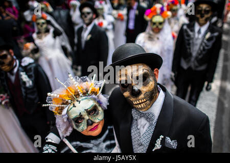 Young couples, costumed as La Catrina, walk through the town during the Day of the Dead celebrations in Mexico City, - Stock Photo