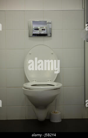 White toilet bowl in bathroom at school - Stock Photo