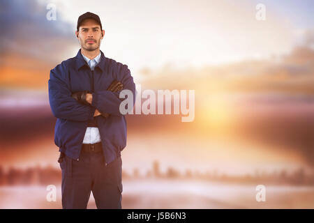 Security standing with arms crossed against cityscape on the horizon - Stock Photo
