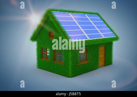 Small model of green house against purple vignette - Stock Photo