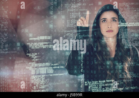 Hacker using digital screen against abstract black room - Stock Photo