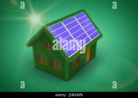 Small model of green house against green vignette - Stock Photo