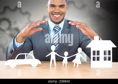 Businessman smiling behind car, family and house illustration against arrows with gears - Stock Photo