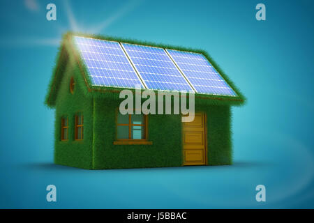 Small model of green house against blue vignette background - Stock Photo