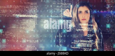 Female hacker using digital screen against black angular design - Stock Photo