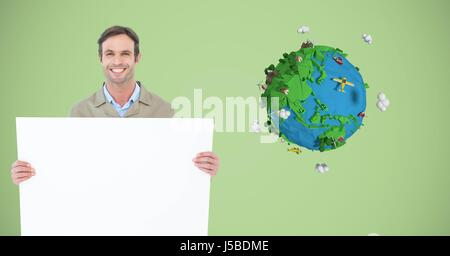 Digital composite of Delivery man holding blank billboard by low poly earth - Stock Photo