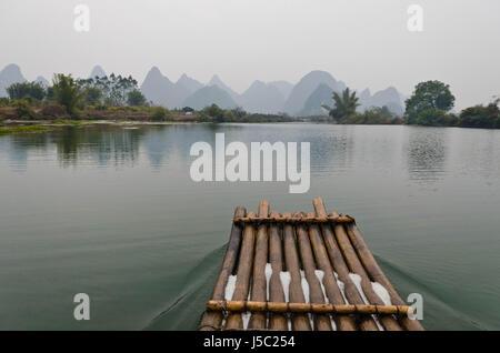 Bamboo rafting on the YuLong River - Stock Photo