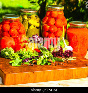 still life from marinated and fresh vegetables on the garden - Stock Photo