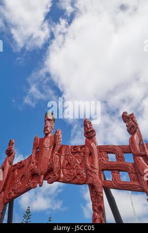Carved Maori totem poles (pou) at Waitangi near Paihia in the Bay of Islands, Northland, New Zealand - Stock Photo