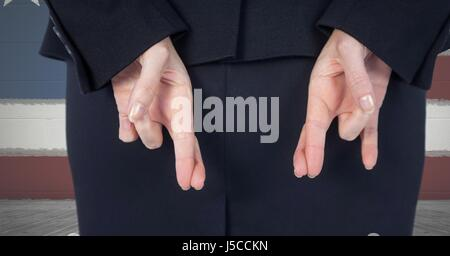 Digital composite of Midsection of businesswoman crossing fingers with American flag in background - Stock Photo
