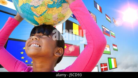 Digital composite of panel with flags in the sky. Girl having fun with earth ball - Stock Photo