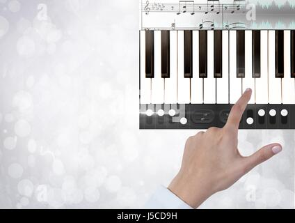 Digital composite of Hand Touching Piano keys with notes and effects App Interface - Stock Photo