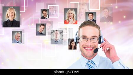 Digital composite of Businessman wearing headphones with portrait graphics - Stock Photo
