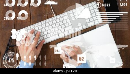 Digital composite of Hands using computer keyboard while writing with overlay - Stock Photo