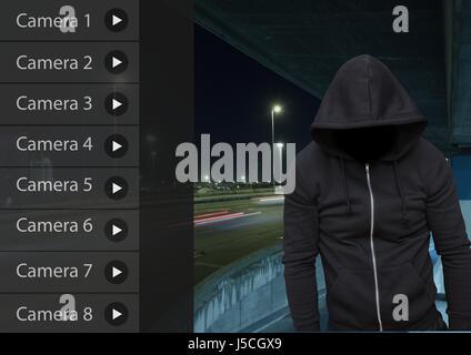 Digital composite of Criminal man on Security Camera App Interface Road Carpark - Stock Photo