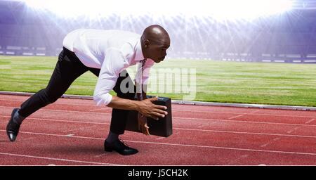Digital composite of Digital composite image of businessman at starting point on racing track - Stock Photo