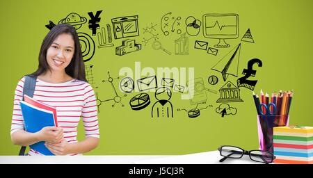 Digital composite of Smiling student holding books against graphics - Stock Photo