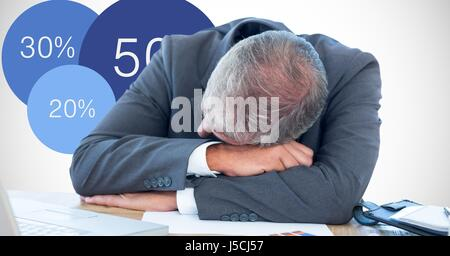 Digital composite of Businessman sleeping on desk by graphics - Stock Photo