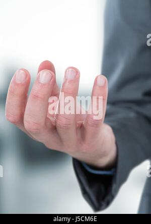 Digital composite of Close-up of businessman's hand - Stock Photo
