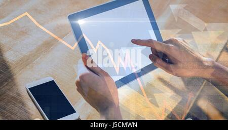 Digital composite of Hands using digital tablet with overlay - Stock Photo
