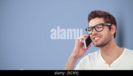 Digital composite of Male hipster using smart phone against blue background - Stock Photo
