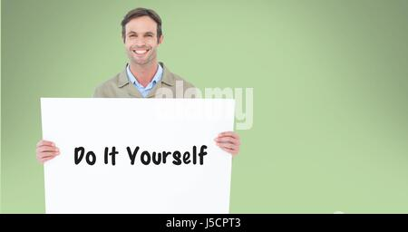 Digital composite of Portrait of man holding billboard with do it yourself text against green background - Stock Photo