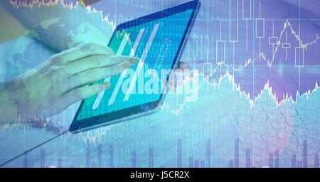 Digital composite of Businesswoman touching digital tablet with graphical overlay - Stock Photo