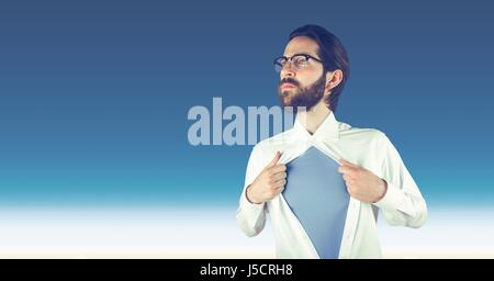 Digital composite of Hipster tearing shirt against sky - Stock Photo