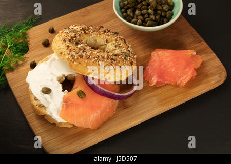 Bagel with cream cheese and lox, place for text - Stock Photo