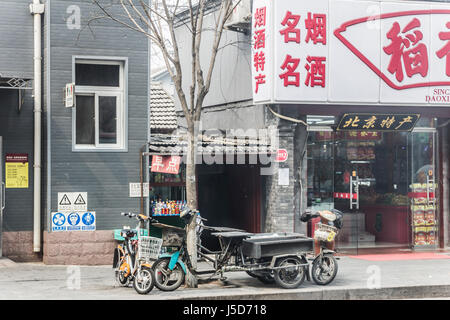 BEIJING, CHINA-CIRCA MARCH 2014:- The shop has been errected in an alley way in the Hutongs. - Stock Photo