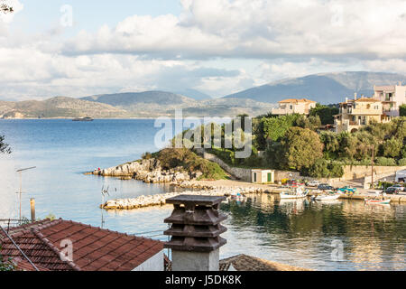 View on the Albanian shore and mountains over the sea and bay in Kassiopi, Corfu, Greece. Incredible clouds on blue - Stock Photo
