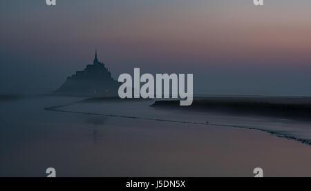 Mont Saint Michel sunrise dawn Couesnon river scenic landscape seascape abbey atmospheric gloomy winding river Mont - Stock Photo