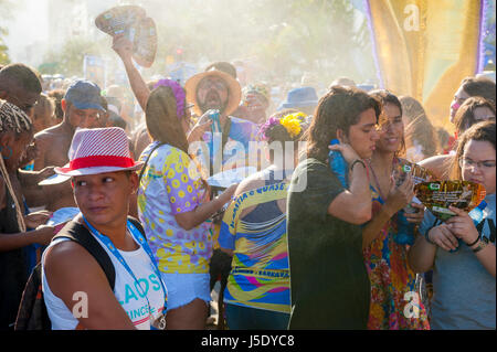 RIO DE JANEIRO - FEBRUARY 18, 2017: An afternoon carnival street party in Ipanema draws crowds of young Brazilians - Stock Photo